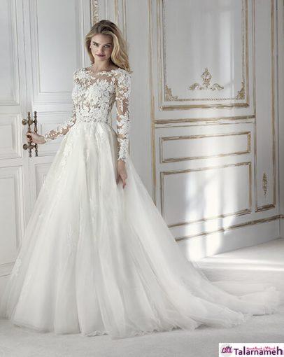 یک لباس عروس جذاب دارای دو قسمت بالا و پائین که در یک نظر، یکسره دیده می شود. دارای یک دامن پف کرده تپل که در قسمت بالای کمر آن بسیار سبک می باشد. قسمت بالا تنه ترکیبی از گیپور و تور متصل به کمر. یک لباس منحصر به فرد برای یک روز منحصر به فرد.
